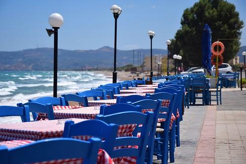 summer mood kissamos crete kreta kriti sea water waves mediterranean table chair restaurant seafront blue lamp tree landscape view town hot