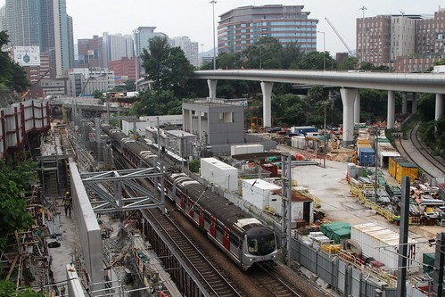MTR East Rail train passes Shatin to Central Link works at Ho Man Tin