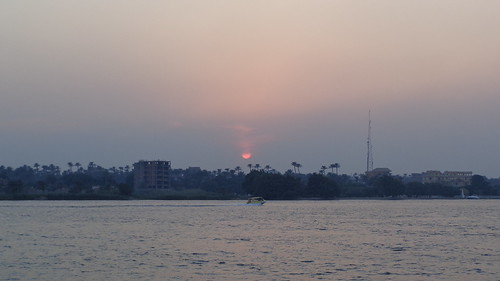sunset nile sunsetsunsunlightmaadicairoegyptafricatraveltravellingwaterwavewavesriverriversnile rivernile sunsetthe river nature outdoors sky