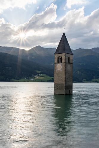 italy italia südtirol steeple sunset sunstar lake clouds hdr water landscape reschensee lagodiresia church trentino alto adige