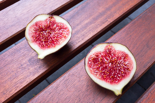 Cross section of two figs: fruit pulp and seeds | by marcoverch