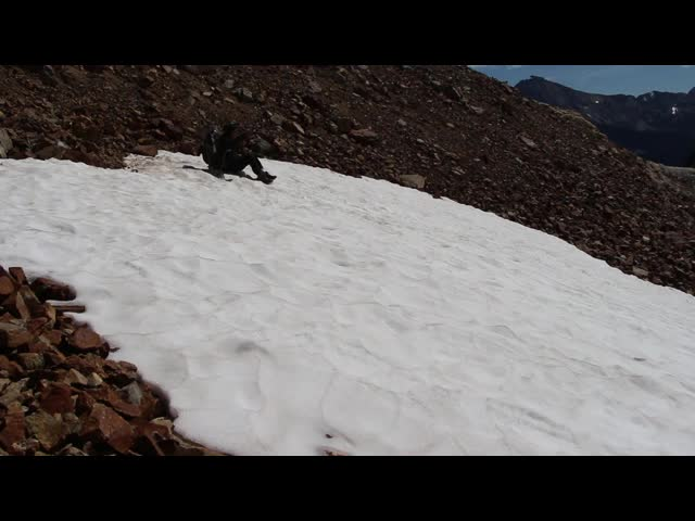 4862 Video of Vicki as she immediately decides to glissade down Spider Glacier from Spider Gap