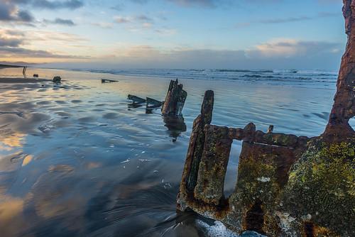 peteriredale fortstevens graveyardofthepacific sunrise ocean beach shipwreck clouds sand waves reflections morning dawn clatsop oregon sea water sky landscape coast