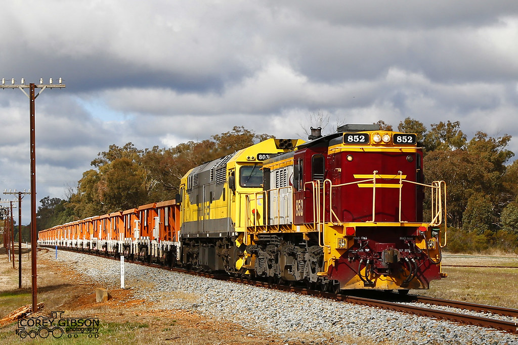 Ballast train with Locomotive's 852 & 8030 passes through Pucawan siding by Corey Gibson