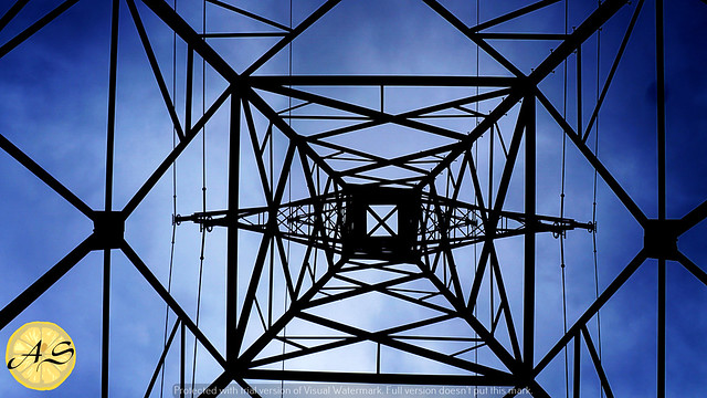 Blue Sky through an electric tower - Copy (1)