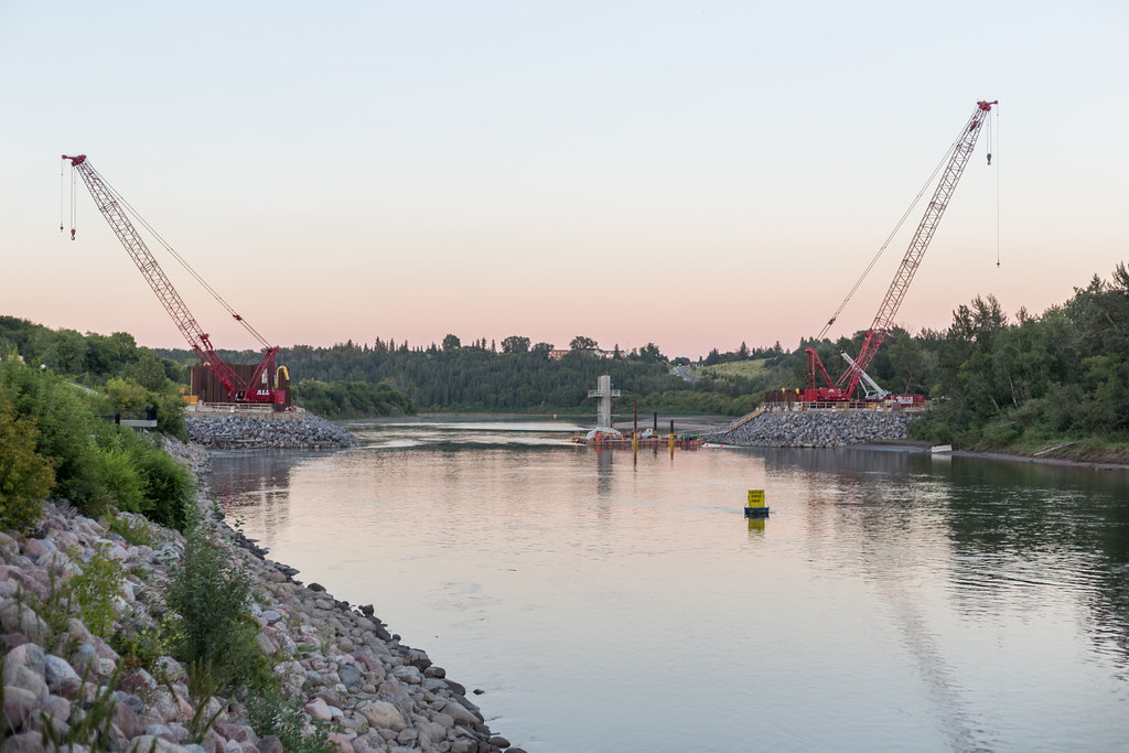 Two cranes hover over the North Saskatchewan River