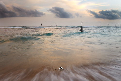 fish srilanka inde water sky red beach sunset nature blue white light sun clouds landscape pink orange fishers sticks