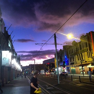 Man looks over his shoulder just as #UFO drops in to abduct him. Nice #clouds & sky over #Chinatown, #Sydney at #sunset too #scifi | by TenguTech