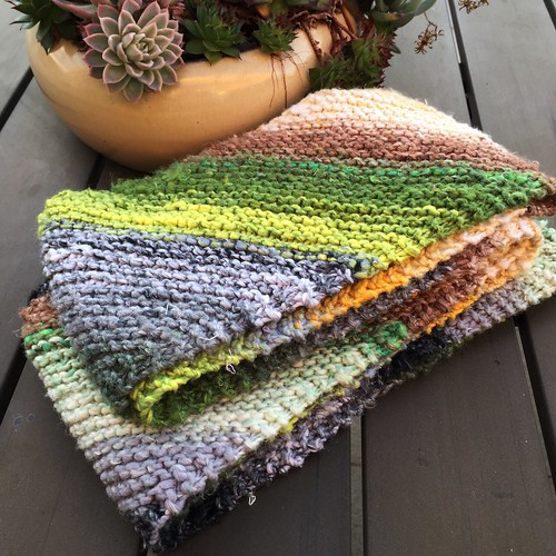 Bias garter stitch scarf in Noro Kureyon.