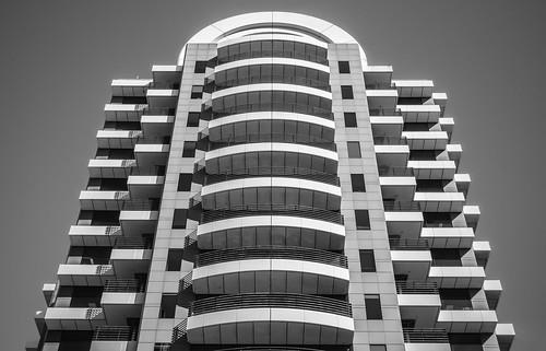 adelaide adelaidecbd city downtown cbd sa southaustralia australia building architecture structure skyscraper angle view symmetry pattern mono monochrome blackandwhite blackwhite bw grayscale image photo picture olympusem10 olympus olympusomd