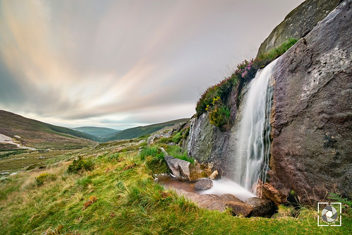 wicklow gap ireland waterfall top sky sunrise winter rocks grass green colours clouds
