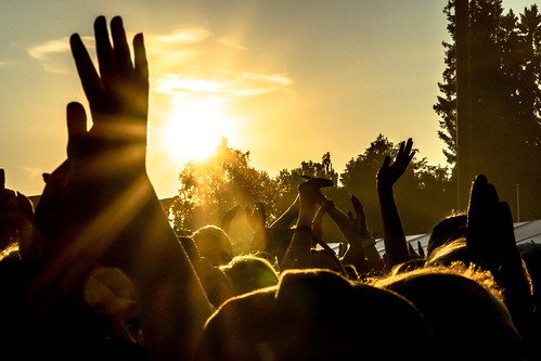 hands in rock festival during sunset | by VisitLakeland