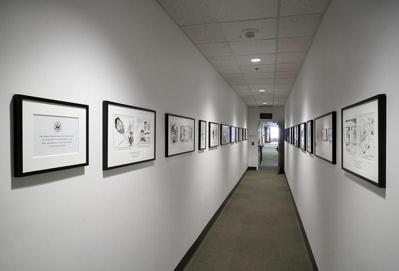 Exhibit of Cartoons about the US District Court, Northern District of California • 18th Floor at entrance of Library produced by Business Image Group • Summer  2017 First Amendment sign on left