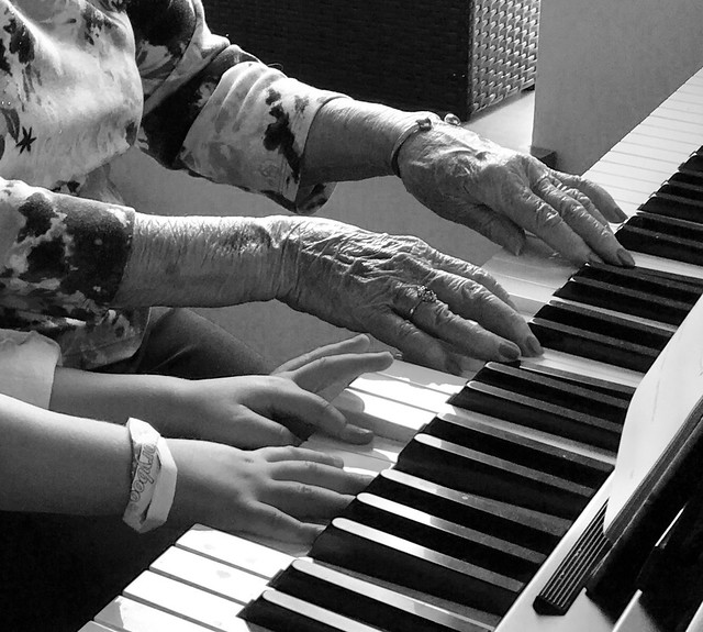 Piano for 4 hands: 2 older, 2 younger