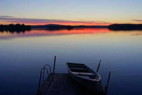 lake sunrise water boat serene calm clouds jetty sweden scandinavia landscape waterscape rowingboat blue nature colourful dawn bluehour