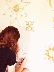 caroline doing two snowflakes on the wall