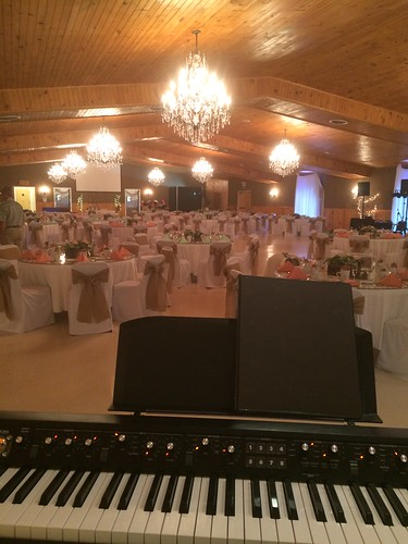 piano keyboard wedding reception hall chandelier tables tablecloth table keys keyboards pianos