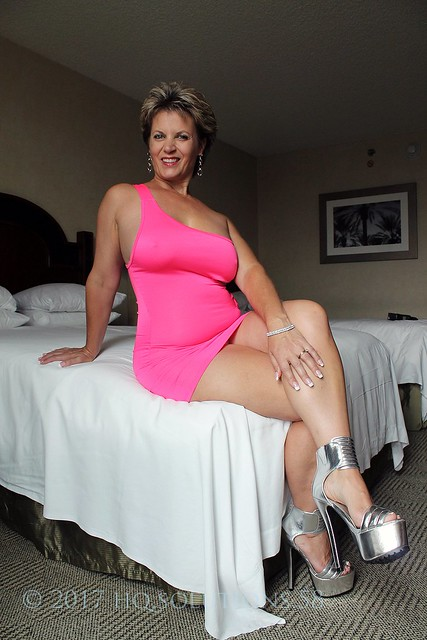 cali steele in hot pink dress and silver stilettos