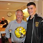 MOM Glenn Murison presents matchball sponsor Michael Stewart with a signed ball