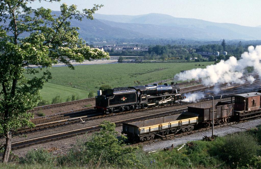 Black 5MT 44767 'George Stephenson' backs light ex Fort Wm Shed. Jun'85.