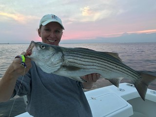 Photo of woman holding striped bass