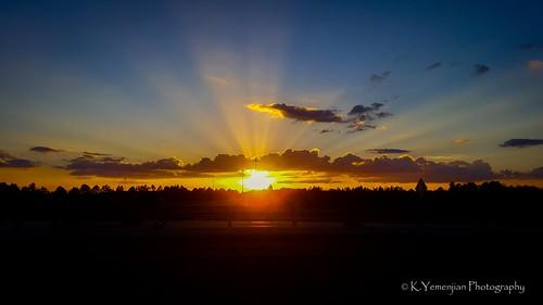 sunlight sunbeam sunset landscape augusta augustaga southeast skyline sky clouds crepuscularrays samsunggalaxys6 samsung galaxys6 mobilephone highway interstate i520 bluesky sun east canon t5i canont5i 700d canon700d placescity