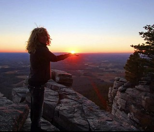 She holds the sun in her hand.  Sunset from the Pilot. Pilot Mountain, North Carolina.  A landmark for Americans since the beginning.