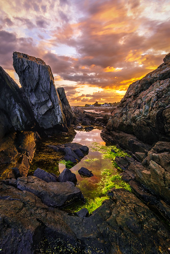 cliff rocky rockface cliffface seascape clouds sunset ocean waves beach seaweed longexposure coast rocks water sea new hampshire