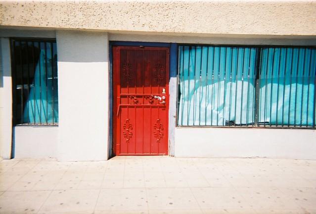 Empty store with red door