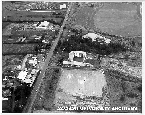 Aerial view of halls site, December 1963, from north with sports oval and drive-in in background