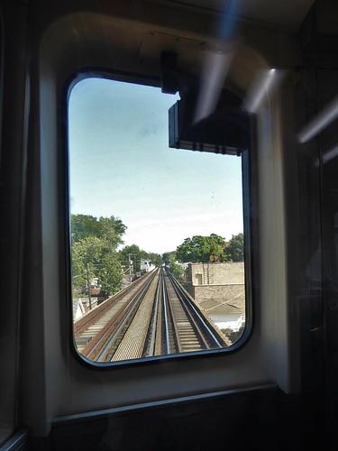 chicago elevatedtrain el transporation train urban sky trees railcar tracks glass window
