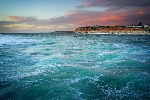 water coast blue cliffs sunset storma tide sea land