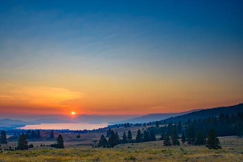 elmo montana unitedstates us sun blue sunrise flatheadlake sky morning orange red