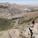Climbing Red Mountain with Mad Wolf Mountain in the background