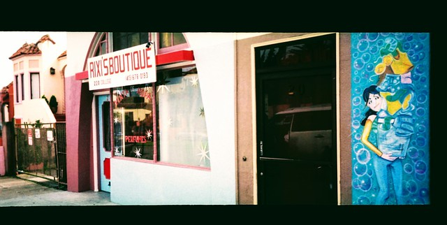 Laundromat, boutique and pink house