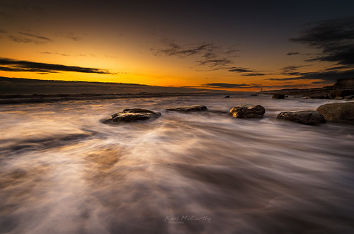 seascape ocean cliffs sunset golden