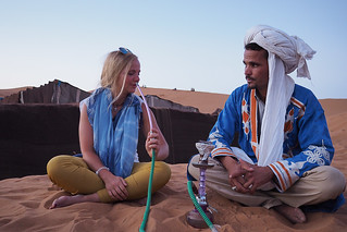 Girl smoking shisha in the desert