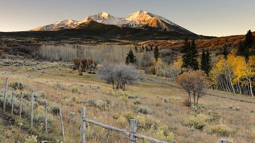 mtsopris elkmountains rustic fallfoliage fallcolors fence rural autumn colorado pasture meadow roaringforkvalley carbondale