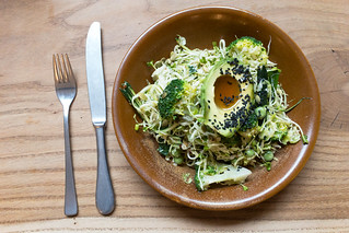 ULTRA GREEN BOWL with shaved brussels sprouts, broccoli, fresh peas, scallions, zucchini, avocado, sesame & pumpkin seeds, sesame oil | by marcoverch