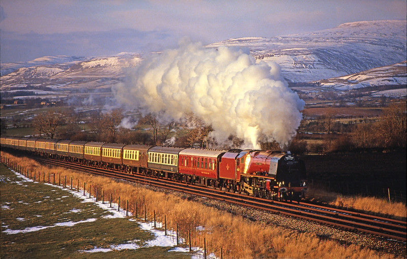 The last rays of a very cold March afternoon catch 46229 'Duchess of Hamilton' approaching Appleby at Keld with The Northern Belle. The Duchess had came on at Eaglescliffe and and took the 14 coach train as far as Leeds via Hartlepool,Newcastle and Carlisle.  Pentax S1A. Fuji 100.