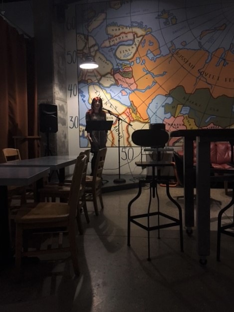 Performing poetry at Cargo Coffee (wide shot edition)