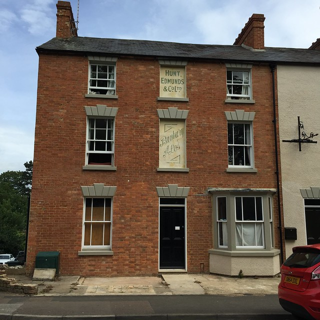 Ghost signs on former Flowing Well pub, 76-78 Broughton Road, Banbury