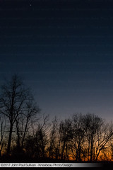 Last light with first star over the trees without leaves on the ridgetop