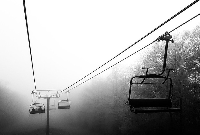 Chairlifts in the mist Mont Sutton