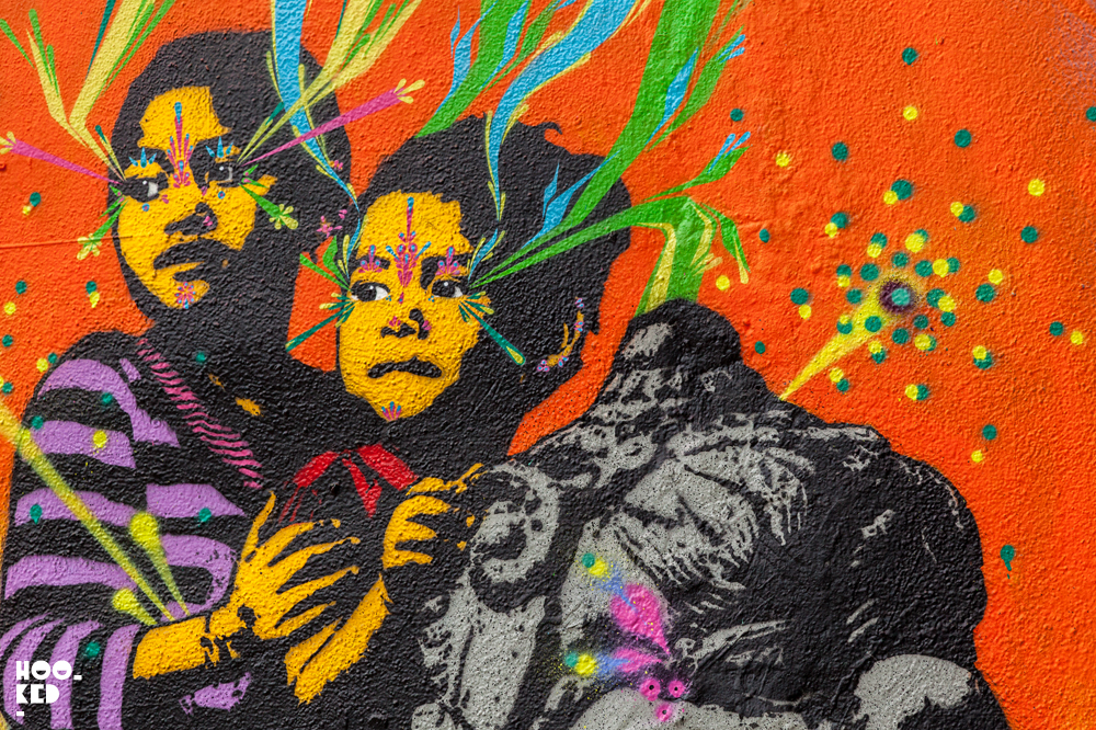 Close-up photograph of the colourful Stinkfish street art mural off Brick Lane