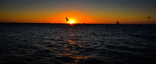 melbournebeach florida unitedstates us panoramic view sunset over indian river melbourne beach fl fla america american usa sun orange yellow water bay ocean atlantic cove