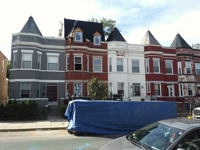 Architecturally suspect third floor addition on a historic rowhouse resulted in the demolition of a special roof projection