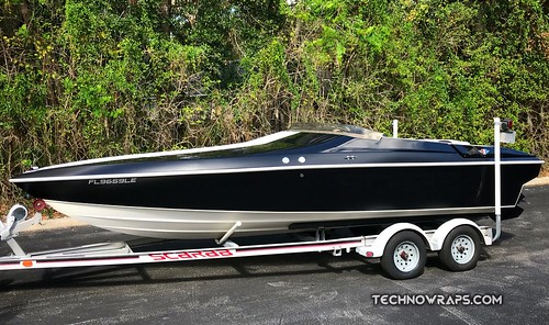 Scarab vinyl boat wrap by TechnoWraps.com in Orlando