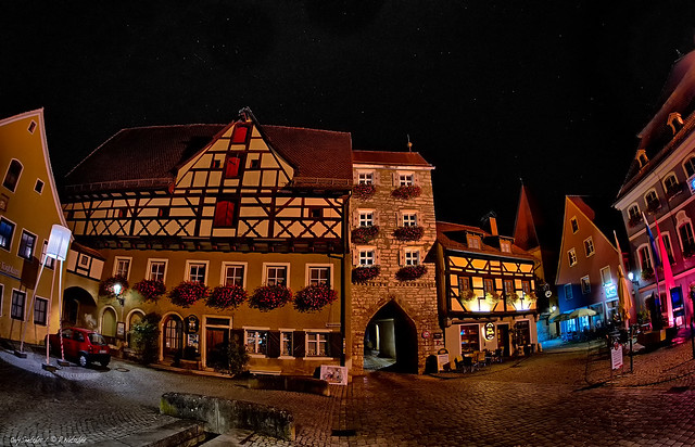 Medieval city under a dark sky