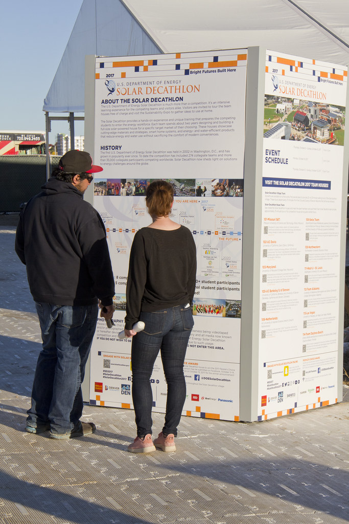 7c44e543a Visitors to the U.S. Department of Energy Solar Decathlon 2017 learn about  the event in the village at the 61st   Peña Station